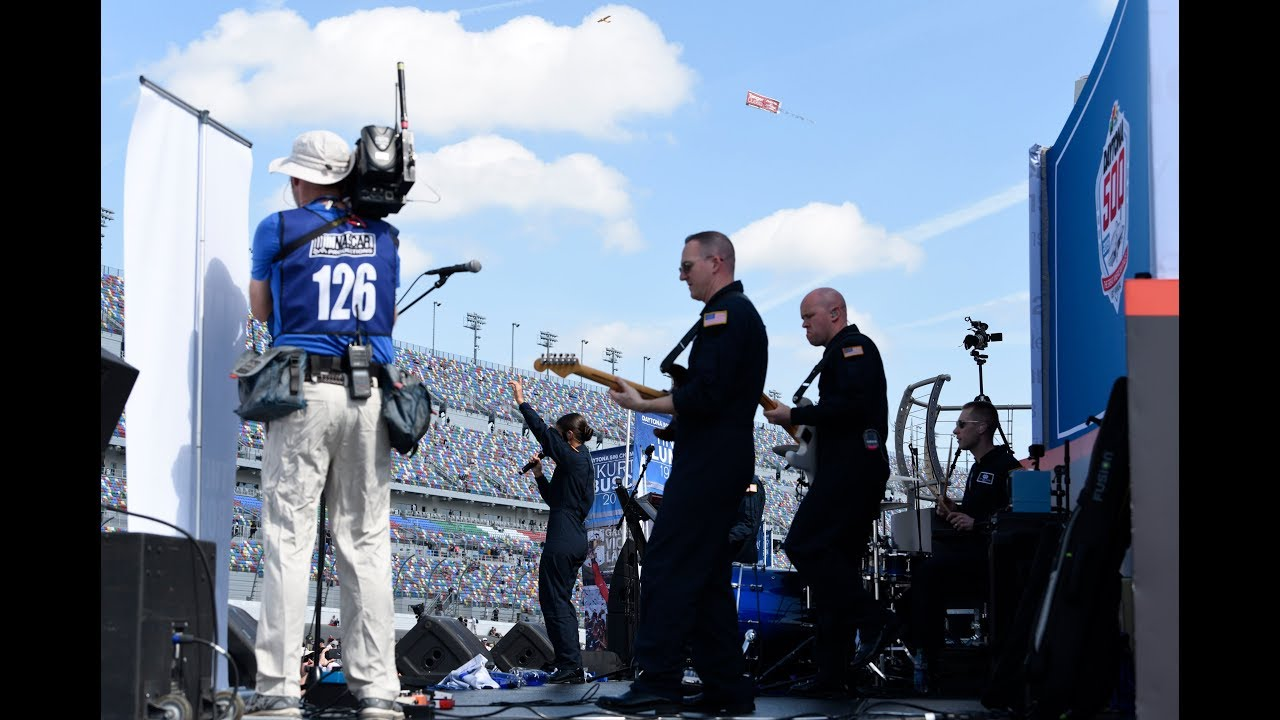 "The U.S. Air Force Premier Rock Band Max Impact performs ""Life Is A Highway"" inside the Daytona International Speedway at the NASCAR Daytona 500 race. 