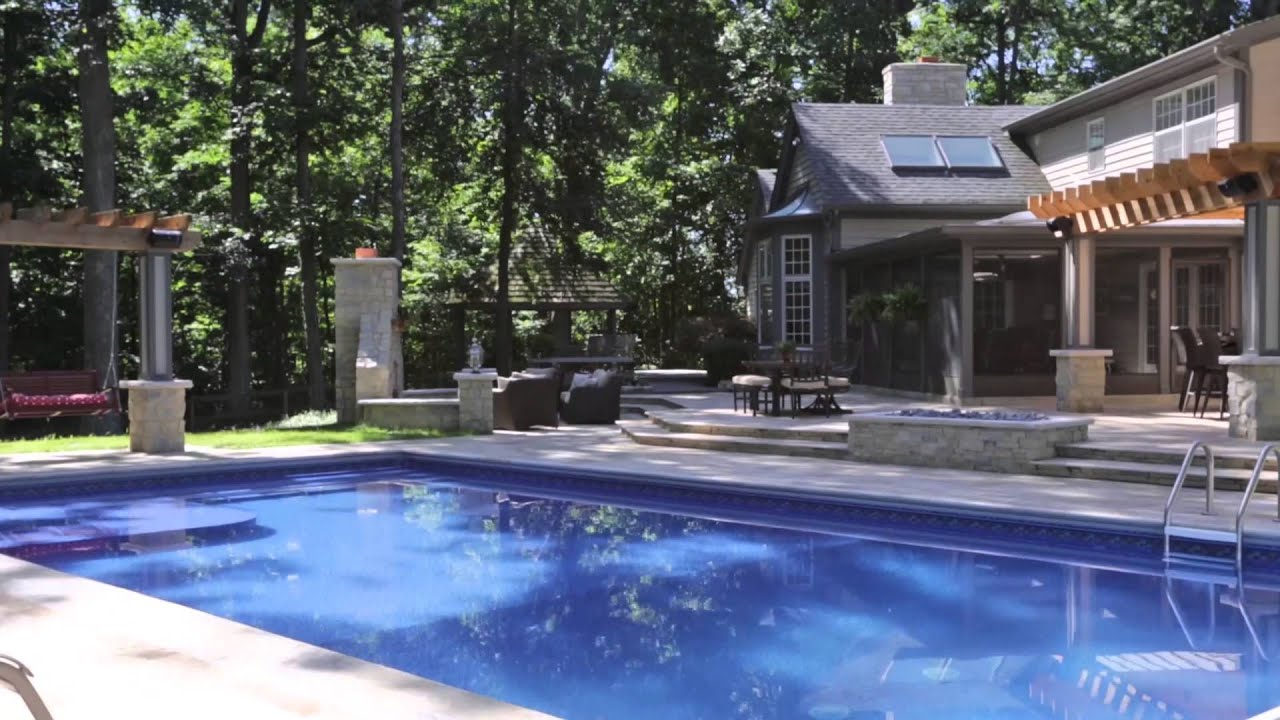 Outdoor fx paver patio fireplace kitchen in ground pool for Pool with fireplace