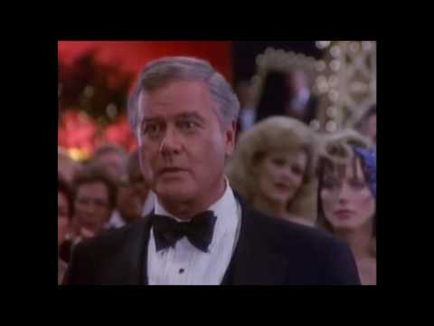 Dallas: Sue Ellen punches J.R at the Oil Barons Ball.