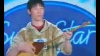 Казахский парень с балалайкой