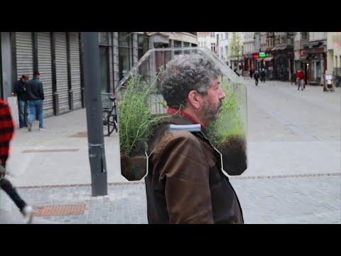 "A Belgian artist has designed a portable pandemic ""bubble"" made of a plexiglass plant pod."