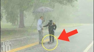 Couple Sees Weird Cop Standing In Rain, Then Realizes What She's Doing