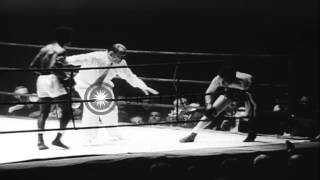 Hogan (Kid) Bassey of Nigeria defeats Cherif Hamia of Algeria, to win Featherweig...HD Stock Footage