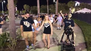 FunnyBone hops on Ghost Horse after riding skateboard at UCF game
