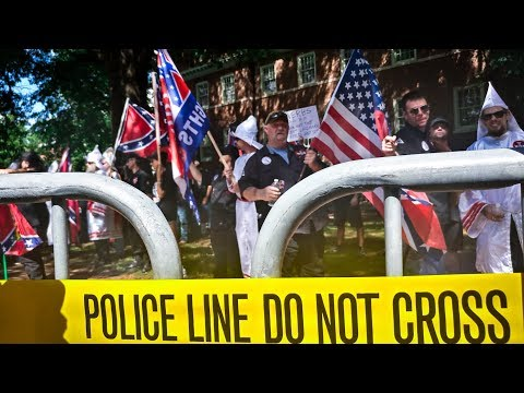 KKK rally for Confederate monument ends early as hundreds protest