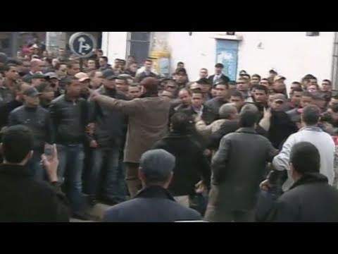 Tunisian Revolts Force President to Flee