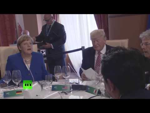 Best friends? Merkel & Trump share private giggle at round table meeting for G7 summit