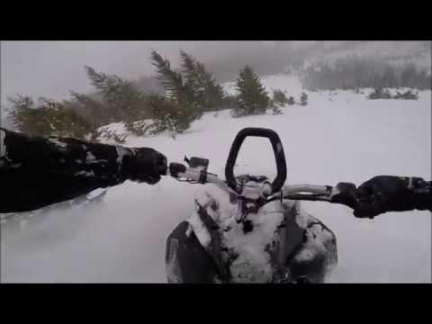SNOWMOBILER OUTRUNS AVALANCHE