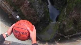 What Happens When a Spinning Basketball is Thrown Off a Dam! thumbnail