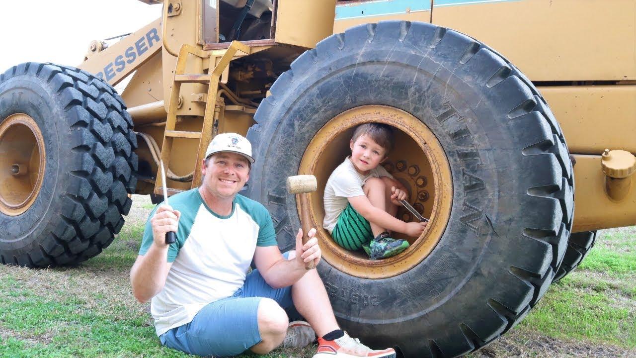 Fixing broken tractor and throwing huge rocks in the water   Tractors for kids