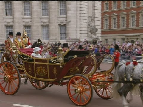 Royal procession: Queen travels by horse and carriage through the streets of London