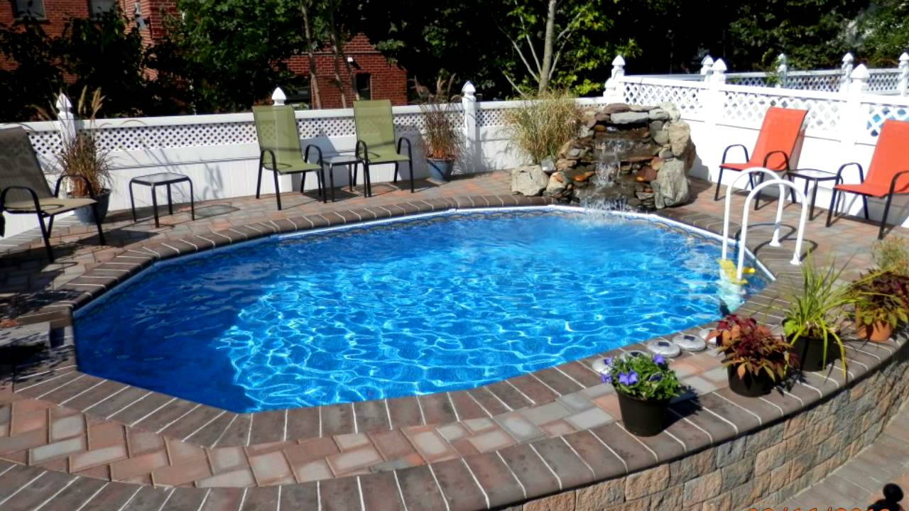 Semi inground swimming pool installs ny youtube for In ground pool companies
