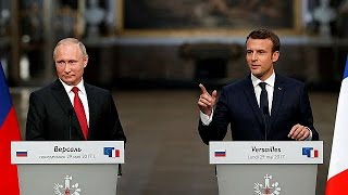 Macron and Putin vow to work together despite disagreements