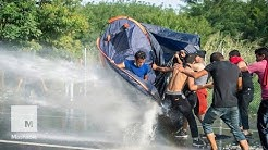 Hungary Unleashes Water Cannons on Migrants at Border | Mashable News