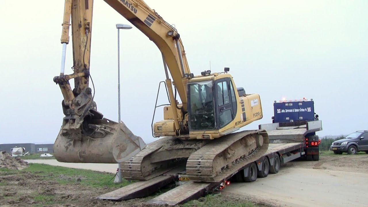 Loading And Unloading The Komatsu Pc210 Excavator