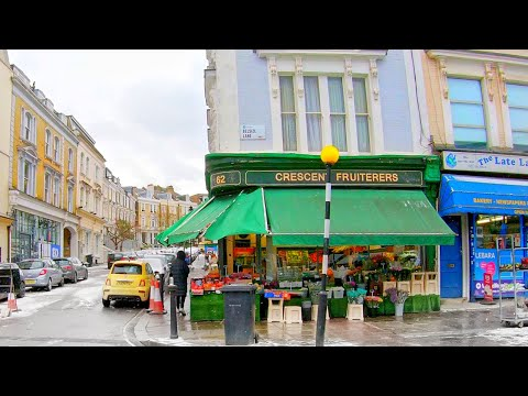 Walking through Belsize Village, North West London on a Snowy Day