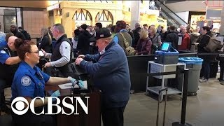 Travelers feel impact of government shutdown as TSA workers call in sick