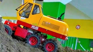 STUNNING RC 3-AXLE EXCAVATOR! ! RC DOZER! RC DUMP TRUCK! RC TRACTOR'S AND MORE...