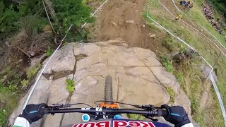 Rachel Atherton's DH MTB Title Winning Run: GoPro View | UCI MTB World Cup 2016(Watch UCI's fastest riders tear up the Mont-Sainte-Anne course: http://win.gs/UCI16CA With the 2016 UCI overall title standing on this run, there was a little ..., 2016-08-08T21:00:50.000Z)