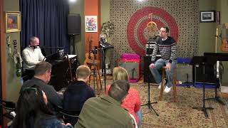 Ethan Performing Some Day At Christmas Main Street Music and Art Studio