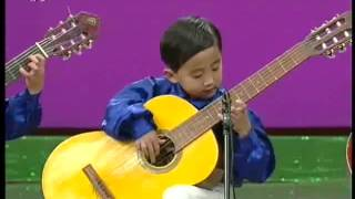 North Korea Kindergarten children playing Guitar at Chongam Kindergarten Chongjin