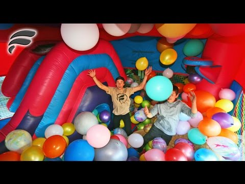 BOUNCE HOUSE SLIDE FILLED WITH 500 BALLOONS!