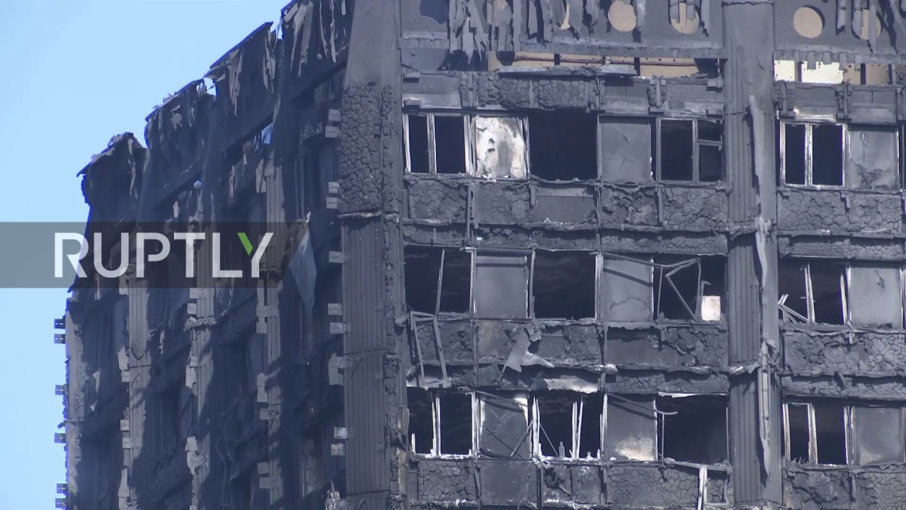 UK: Grenfell Tower still smoulders day after deadly fire kills 12