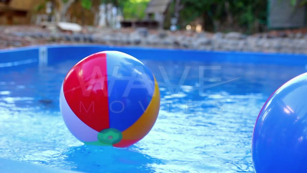 Pool Water With Beach Ball colorful beach ball thrown into the water in the pool - youtube