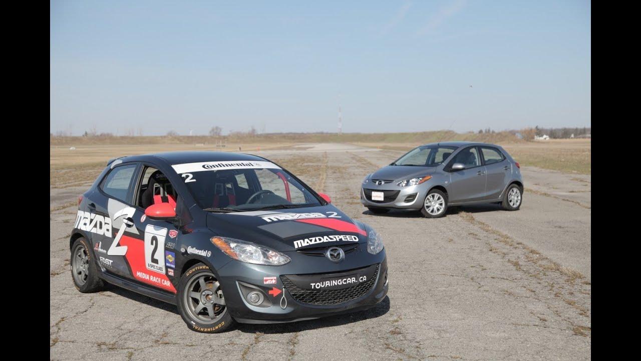 2013 mazda2 vs 2013 mazda2 b-spec race car - youtube