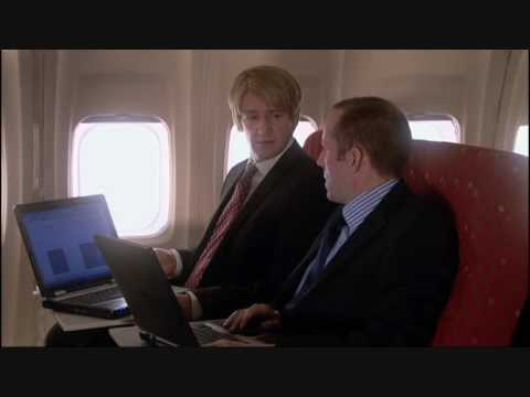 Armstrong and Miller - Businessmen on an Airplane