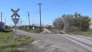 The Southbound KCS G-JVMX At Victoria, TX With White Ghost KCS Grain Hoppers