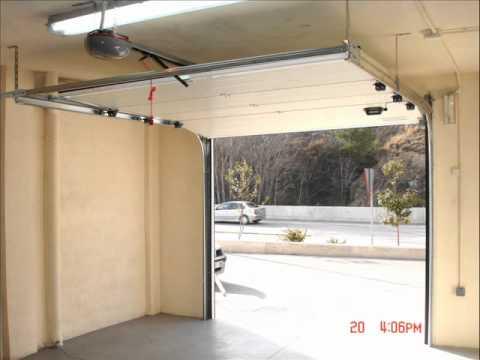 Sustitucion puerta basculante youtube for Precio de puertas electricas
