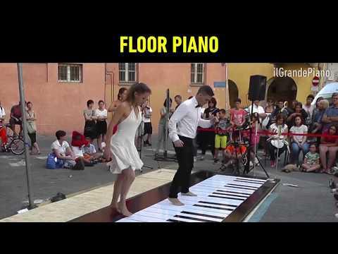 Professionnal dance on giant floor piano