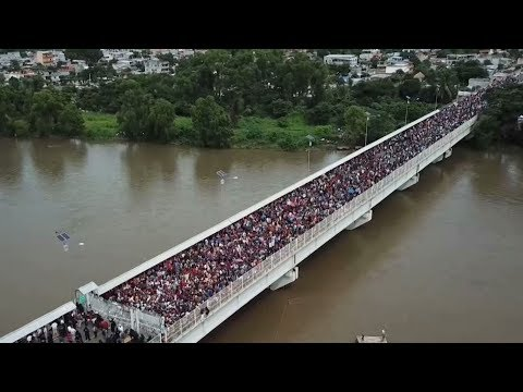 Migrants stranded on bridge as Mexican police prevent entry from Guatemala