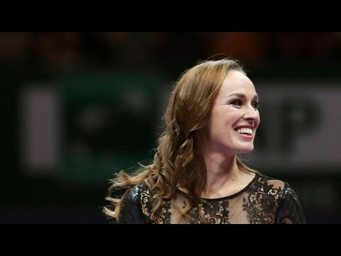 Martina Hingis wipes away tears after retiring from tennis