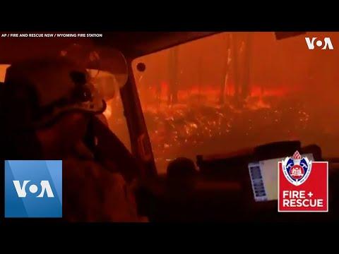 Australia Firefighters Drive Through Inferno