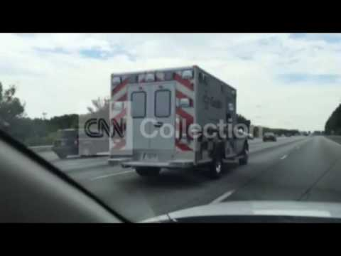 EBOLA PATIENT TRANSPORT ON HIGHWAY (GOOD VIDEO)