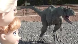 Elsa and Anna dolls go to Dinosaur Land park and see dinosaurs, cavemen and play at the park