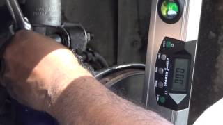 using spirit level to camber car wheel