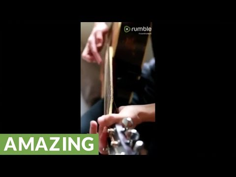 Artist creates incredible tune out of broken guitar