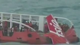 AirAsia plane tail brought to the surface