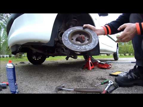 peugeot 207 changing the rear brake discs removing doovi. Black Bedroom Furniture Sets. Home Design Ideas