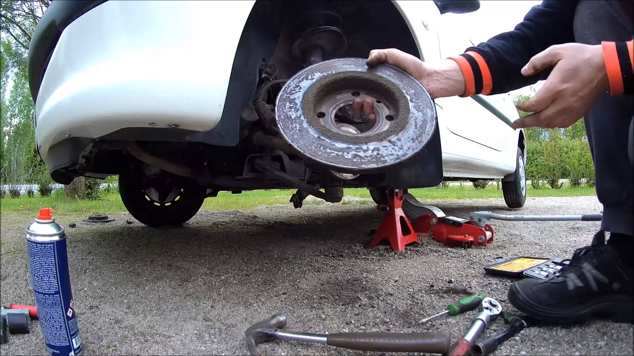 peugeot 206 - how to change front brake discs and pads - youtube