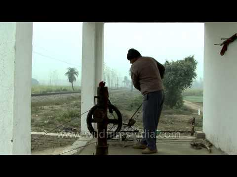 Railway crossing lever being operated manually in India