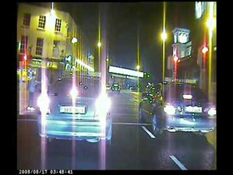 Drunken Idiot nearly gets bonneted by Taxi