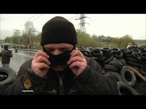 Ukraine's president urges gunmen to lay down weapons