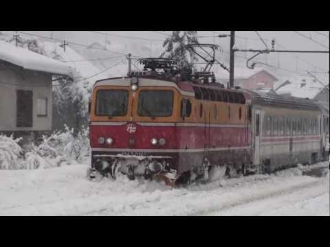 Diesel Dashing Through The Snow With A Delayed Passenger Train