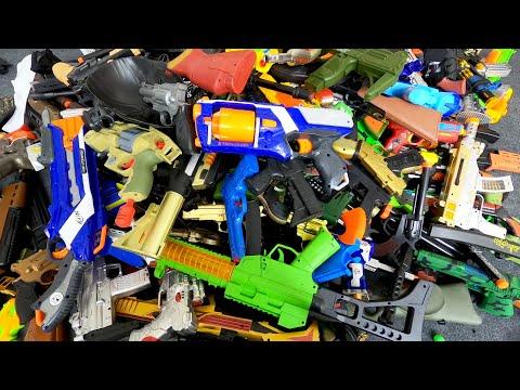 Hundreds of Toy Guns and Rifles. A variety of weapons. Shotguns, Nerf Guns, Bead Guns - Box of Toys