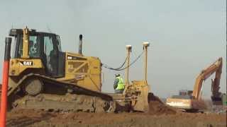 cat d6n and cat 815b work with sidedumps for new mississippi river bridge