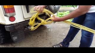mahindra thar pulling the suzuki eeco out of sludge